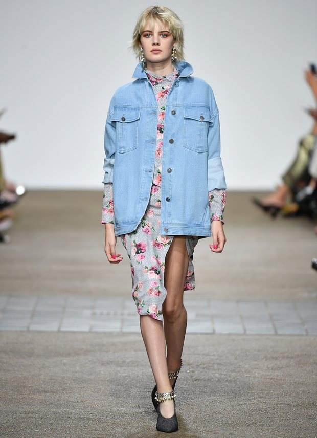 An oversized denim jacket over a floral dress, as seen at the Topshop Unique show